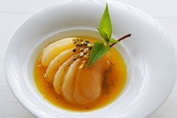 Poached pear with citrus fruits, Honey, pistachio and Matcha tea